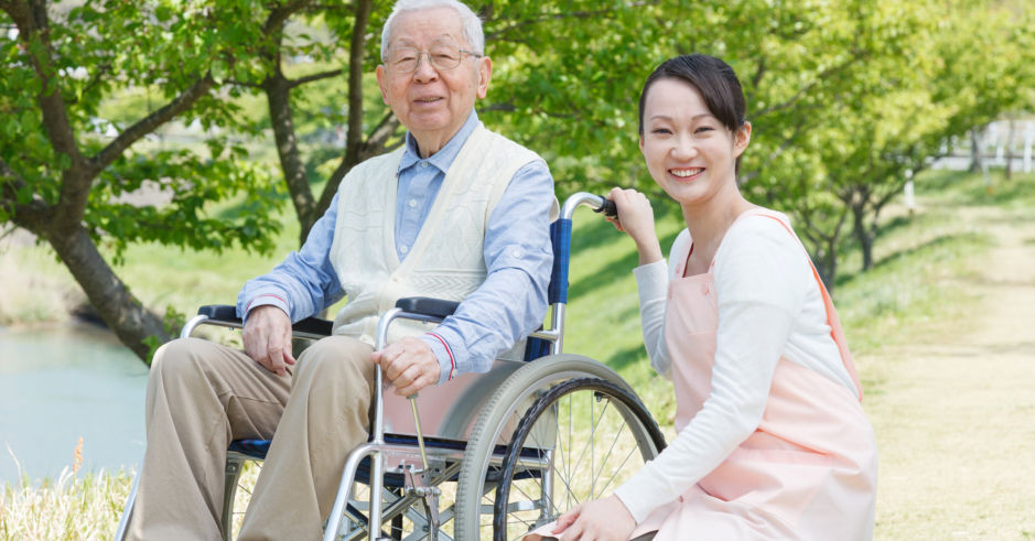asian-elderly-in-wheelchair-with-caregiver